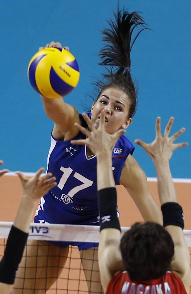 Russia's Natalia- Malykh spikes the ball against Japan's Miyu Nagaoka during the final round of the Women's Volleyball World Grand Prix in Tokyo, Wednesday, Aug. 20, 2014