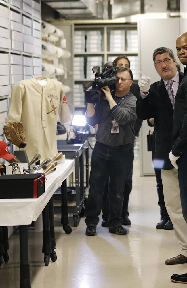 Former Chicago White Sox player Frank Thomas, right, visits the archives area with Erik Strohl, vice president for exhibitions and collections, during an orientation visit at the Baseball Hall of Fame on Monday, March 3, 2014, in Cooperstown, N.Y. Thomas will be inducted to the hall in July