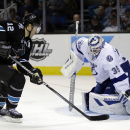 San Jose Sharks' Patrick Marleau (12) scores past Tampa Bay Lightning goalie Anders Lindback, of Sweden, during the third period of an NHL hockey game on Thursday, Nov. 21, 2013, in San Jose, Calif The Associated Press