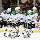 Dallas Stars center Tyler Seguin (91) heads to the bench with teammates Jamie Benn (14), Trevor Daley (6) and Jason Spezza (90) after scoring against the Detroit Red Wings in the second period during an NHL hockey game in Detroit Thursday, Dec. 4, 2014 Th