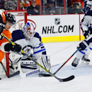 Philadelphia Flyers' Petr Straka (51) left, digs for the loose puck as Winnipeg Jets goalie Michael Hutchinson (34), center, and Mark Stuart (5), right, defend in the second period of an NHL hockey game, Thursday, Jan. 29, 2015, in Philadelphia The Associ