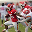 Kansas City Chiefs running back Charcandrick West (35) eludes the grasps of defenders during a NFL training camp, Wednesday, July 30, 2014 on the Missouri Western State University campus in St. Joseph. Mo The Associated Press