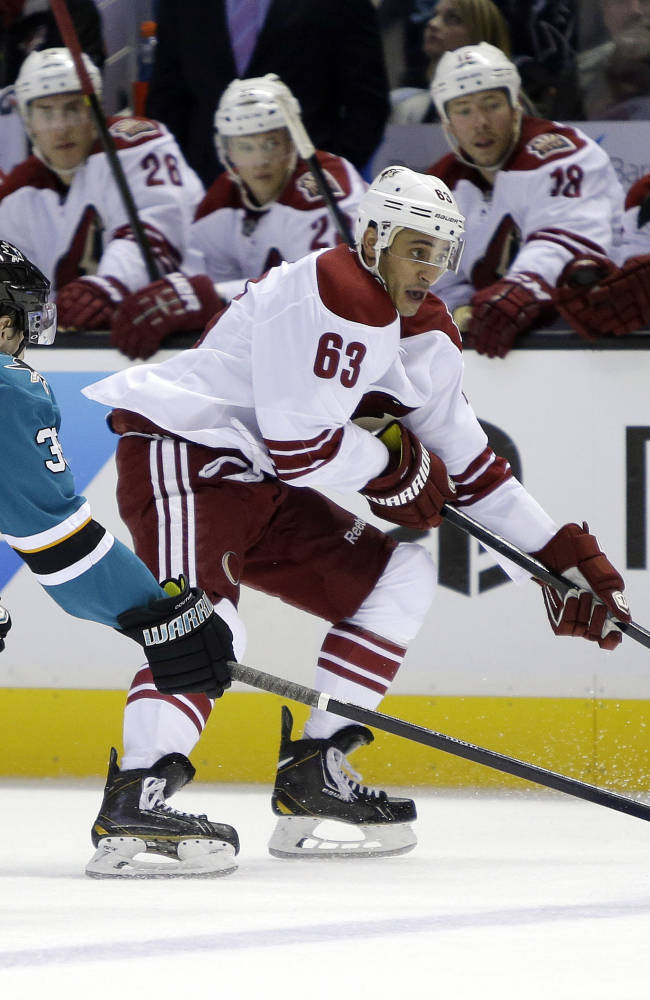 Phoenix Coyotes' Mike Ribeiro (63) is chased by San Jose Sharks' Logan Couture (39) during the second period of an NHL hockey game on Saturday, Nov. 2, 2013, in San Jose, Calif