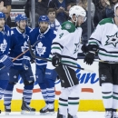 Toronto Maple Leafs' Nazem Kadri, third from right, is congratulated by Joffrey Lupul, (19) and Mike Santorelli, second from left, after scoring his team's second goal against Dallas Stars during the first period of an NHL hockey game, Tuesday, Dec. 2, 20