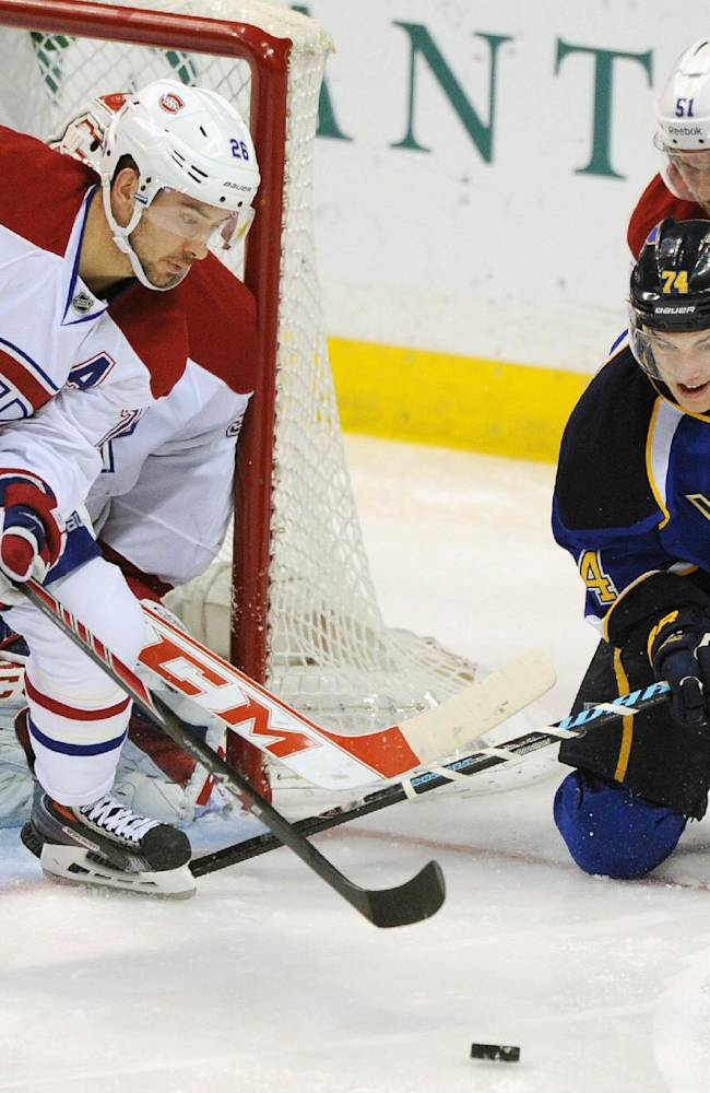 Montreal Canadiens' Josh Gorges (26) and Raphael Diaz (51), of Switzerland, defend against St. Louis Blues' T.J. Oshie (74) during the second period of an NHL hockey game on Thursday, Dec. 19, 2013, in St. Louis