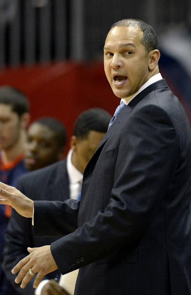 Auburn head coach Tony Barbee calls a play against Illinois in the first half of an NCAA college basketball game on Sunday, Dec. 8, 2013, in Atlanta