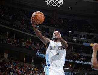 DENVER, CO - MARCH 27: Ty Lawson #3 of the Denver Nuggets goes for the lay up against the Utah Jazz during the game on March 27, 2015 at Pepsi Center in Denver, Colorado. (Photo by Garrett Ellwood/NBAE via Getty Images)
