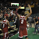 Massachusetts guard Derrick Gordon (2) raises his arms to the crowd as he and Chaz Williams (3) heads off the court after they beat George Mason 88-87 in an NCAA college basketball game, Wednesday, Jan. 15, 2014, in Fairfax, Va. (AP Photo/Nick Wass)