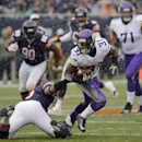 Minnesota Vikings running back Jerick McKinnon (31) avoids getting tackled by Chicago Bears linebacker Lance Briggs during the first half of an NFL football game Sunday, Nov. 16, 2014 in Chicago The Associated Press