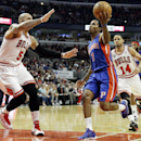 Detroit Pistons guard Brandon Jennings (7) drives to the basket against Chicago Bulls forward Carlos Boozer (5) during the first half of an NBA basketball game in Chicago on Friday, April 11, 2014 The Associated Press