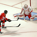 A shot by Chicago Blackhawks' Brandon Saad goes by Detroit Red Wings goalie Petr Mrazek and hits the post in overtime in an NHL exhibition hockey game in Chicago on Tuesday, Sept. 23, 2014. The Blackhawks won 2-1. The Associated Press