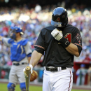 Arizona Diamondbacks' Paul Goldschmidt reacts after striking out against Los Angeles Dodgers pitcher Zack Greinke during the first inning of a baseball game on Saturday, April 12, 2014, in Phoenix The Associated Press