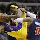 Detroit Pistons center Andre Drummond (0) fouls Los Angeles Lakers center Jordan Hill on an inbound pass during the first quarter of an NBA basketball game at the Palace in Auburn Hills, Mich., Friday, Nov. 29, 2013 The Associated Press