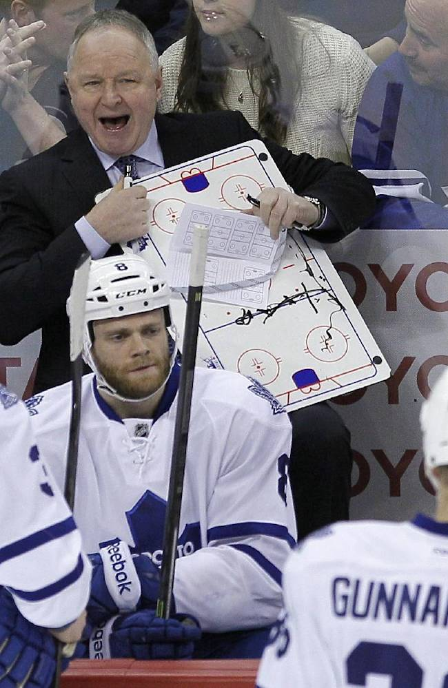Toronto Maple Leafs coach Randy Carlyle talks to his players during the first period of an NHL hockey game against the Winnipeg Jets on Saturday, Jan. 25, 2014, in Winnipeg, Manitoba