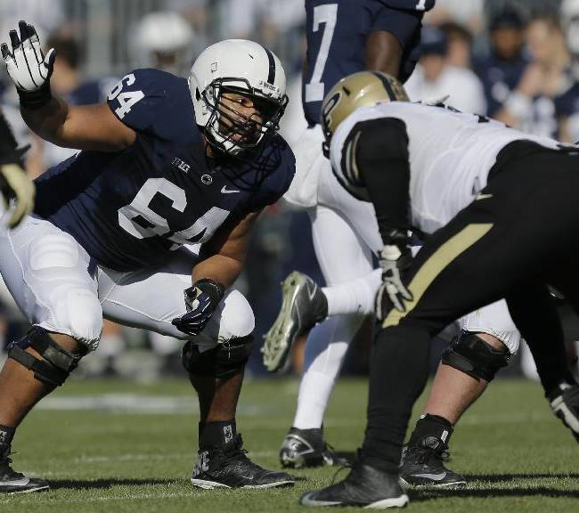 In this Nov. 16, 2013 file photo, Penn State guard John Urschel (64) lines up during the first quarter of an NCAA college football game against Purdue in State College, Pa. The most exciting thing about finishing the combine is that I am no longer training like a track athlete. I am once again a football player, and now am focused on doing all I can to ensure that I am prepared for my pro day