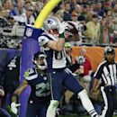 New England Patriots wide receiver Danny Amendola (80) catches a four-yard touchdown pass in front of Seattle Seahawks free safety Earl Thomas (29) during the second half of NFL Super Bowl XLIX football game Sunday, Feb. 1, 2015, in Glendale, Ariz The Ass