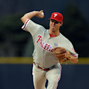 Philadelphia Phillies starting pitcher Jonathan Pettibone throws to the plate against the Colorado Rockies during the first inning of a baseball game on Friday, April 18, 2014, in Denver. (AP Photo/Jack Dempsey)