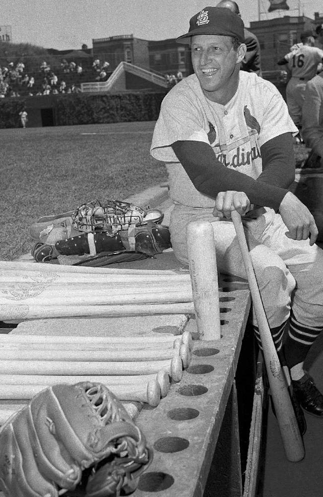 In this May 13, 1958 file photo, Stan Musial, St. Louis Cardinal all-time great baseball player, poses in dugout prior a baseball game in Chicago against the Chicago Cubs, in which he made his 3,000th career hit. Musial, one of baseball's greatest hitters and a Hall of Famer with the Cardinals for more than two decades, died Saturday, Jan. 19, 2013. He was 92