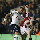 Tottenham's Kyle Walker, left vies for the ball with Sheffield United's James Murphy during their English League Cup semifinal 1st leg soccer match between Tottenham Hotspur and Sheffield United, at the White Hart Lane stadium in London, Wednesday, Jan 2