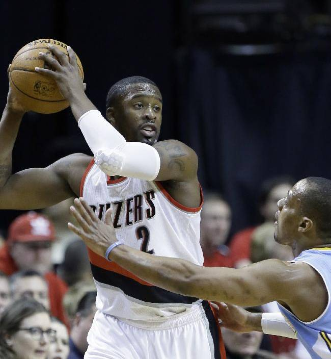 Portland Trail Blazers guard Wesley Matthews, left, looks to pass against Denver Nuggets guard Randy Foye during the first half of an NBA basketball game in Portland, Ore., Thursday, Jan. 23, 2014