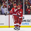Detroit Red Wings forward Henrik Zetterberg (40), of Sweden, celebrates with forward Gustav Nyquist (14), of Sweden, after Nyquist scored a goal during the first period of an NHL hockey game against the Ottawa Senators in Detroit, Monday, Nov. 24, 2014 Th