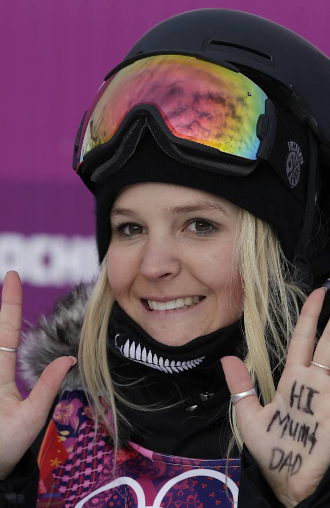 New Zealand's Anna Willcox-Silfverberg displays messages on her hands after a run in the women's freestyle skiing slope style qualifying at the Rosa Khuto Extreme Park at the 2014 Winter Olympics, Tuesday, Feb. 11, 2014, in Krasnaya Polyana, Russia