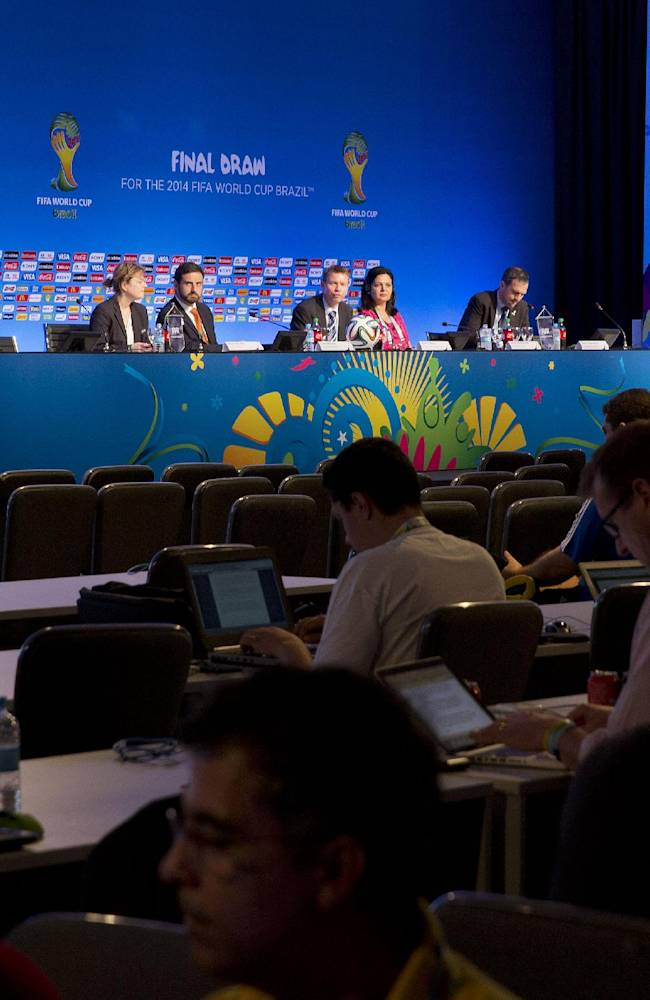 Members of the organizing committee hold a press conference ahead of the World Cup draw at the beach resort of Costa do Sauipe, Brazil, Wednesday, Dec. 4, 2013. The draw for the 2014 World Cup finals takes place Friday