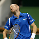 Russia's Nikolay Davydenko reacts after losing a point against France's Richard Gasquet during their final match at Qatar ATP Open Tennis tournament in Doha, Qatar, Saturday,  Jan. 5, 2013.  (AP Photo/Osama Faisal)