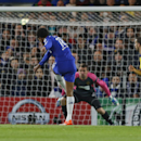 Chelsea's Loic Remy scores his team's first goal passing Maribor's goalkeeper Jasmin Handanovic, rear, during the Group G Champions League match between Chelsea and Maribor at Stamford Bridge stadium in London, Britain, Tuesday, Oct. 21, 2014