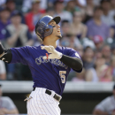 Gonzalez's bloop single lifts Rockies past Braves 3-2 The Associated Press