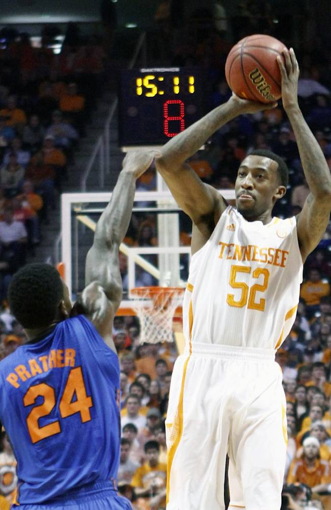 Tennessee guard Jordan McRae (52) shoots over Florida forward Casey Prather (24) in the first half of an NCAA college basketball game on Tuesday, Feb. 11, 2014, in Knoxville, Tenn