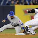 New York Yankees' Carlos Beltran, right, slides into second with a double as Chicago Cubs' Darwin Barney applies the late tag during the first inning of Game 2 of an interleague baseball doubleheader on Wednesday, April 16, 2014, at Yankee Stadium in New