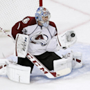 Colorado Avalanche goalie Semyon Varlamov (1) makes a glove save during the third period of an NHL hockey game against the Chicago Blackhawks Tuesday, March 4, 2014, in Chicago. The Avalanche won 4-2 The Associated Press