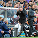 Aston Villa manager Paul Lambert, center, gestures during the English Premier League soccer match against Southampton at Villa Park, Birmingham, England, Saturday April 19, 2014