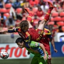 Real Salt Lake's Ned Grabavoy takes a ride on the back of Seattle Sounders' Gonazlo Pineda after both men went up to attempt a header in the second half of an MLS soccer game Saturday, Aug. 16, 2014, in Sandy, Utah The Associated Press
