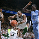 Michigan State's Adreian Payne, left, grabs a rebound against North Carolina's Joel James (42) during the first half of an NCAA college basketball game, Wednesday, Dec. 4, 2013, in East Lansing, Mich. (AP Photo/Al Goldis)