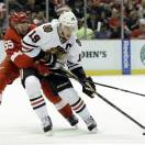 Detroit Red Wings defenseman Niklas Kronwall (55), of Sweden, defends Chicago Blackhawks center Jonathan Toews (19) during the first period in Game 4 of the Western Conference semifinals in the NHL hockey Stanley Cup playoffs series in Detroit, Thursday, May 23, 2013. (AP Photo/Paul Sancya)