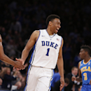 Duke's Jabari Parker (1) celebrates with teammate Rodney Hood (5) during the second half of an NCAA college basketball game against UCLA, Thursday, Dec. 19, 2013, in New York. Duke won 80-63. (AP Photo/Jason DeCrow)