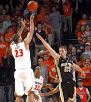 Virginia forward Mike Scott (23) shoots over Wake Forest forward Nikita Mescheriakov (25) during the first half of an NCAA college basketball game Wednesday, Feb. 8, 2012, in Charlottesville, Va. (AP Photo/Andrew Shurtleff)