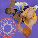 Los Angeles Lakers center Chris Kaman, right, puts up a shot as Oklahoma City Thunder forward Serge Ibaka, of Congo, defends during the first half of an NBA basketball game Thursday, Feb. 13, 2014, in Los Angeles The Associated Press