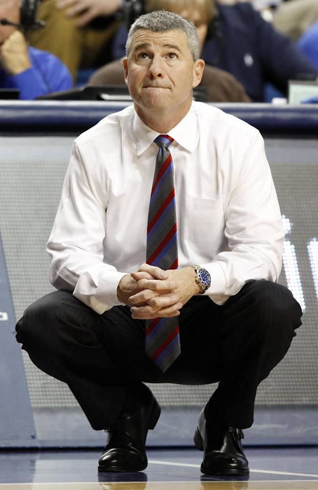 Boise State head coach Leon Rice watches his team during the second half of an NCAA college basketball game against  Kentucky, Tuesday, Dec. 10, 2013, in Lexington, Ky. Kentucky won 70-55