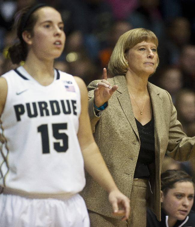 Purdue's head coach Sharon Versyp, right, watches the action with player Courtney Moses (15) during an NCAA college basketball game against Indiana, Friday, Jan. 17, 2014, in West Lafayette, Ind. Purdue won 86-53