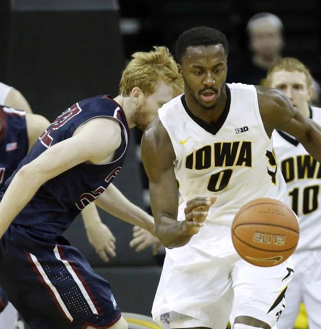 Iowa center Gabriel Olaseni (0) runs down a loose ball during the second half of an NCAA college basketball game against Fairleigh Dickinson, Monday, Dec. 9, 2013, in Iowa City, Iowa. Olaseni scored 14 points as Iowa won 92-59