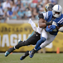 In this Sept. 29, 2013, photo, Indianapolis Colts wide receiver Reggie Wayne (87) catches a pass in front of Jacksonville Jaguars free safety Josh Evans during an NFL football game in Jacksonville, Fla. Wayne is trying to return from a torn anterior cruc