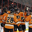 Philadelphia Flyers', from left, Wayne Simmonds, Claude Giroux, Jakub Voracek, of the Czech Republic, Brayden Schenn and Mark Streit, of Switzerland, celebrate after a goal by Varacek during the second period of an NHL hockey game against the Carolina Hur