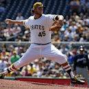 Pittsburgh Pirates starting pitcher Gerrit Cole delivers during the first inning of a baseball game against the Milwaukee Brewers in Pittsburgh, Sunday, April 20, 2014 The Associated Press