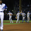 New York Mets players high-five each other as Atlanta Braves' Jason Heyward, left, walks off the field after flying out in the ninth inning to end a baseball game, Tuesday, April 8, 2014, in Atlanta. New York won 4-0 The Associated Press