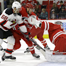 Carolina Hurricanes' Victor Rask and goalie Cam Ward (30) defend against New Jersey Devils' Jaromir Jagr (68), of the Czech Republic, during the first period of an NHL hockey game in Raleigh, N.C., Monday, Dec. 8, 2014 The Associated Press