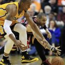 Indiana Pacers' David West and Chicago Bulls' Carlos Boozer battle for a loose ball during the first half of an NBA basketball game, Wednesday, April 25, 2012, in Indianapolis. (AP Photo/Darron Cummings)