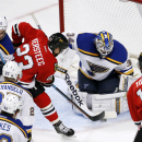 St. Louis Blues goalie Jake Allen (34) makes a save on Chicago Blackhawks right wing Kris Versteeg (23) as Barret Jackman (5), Alex Pietrangelo (27), David Backes (42) and Jonathan Toews watch during the second period of an NHL hockey game Wednesday, Dec.